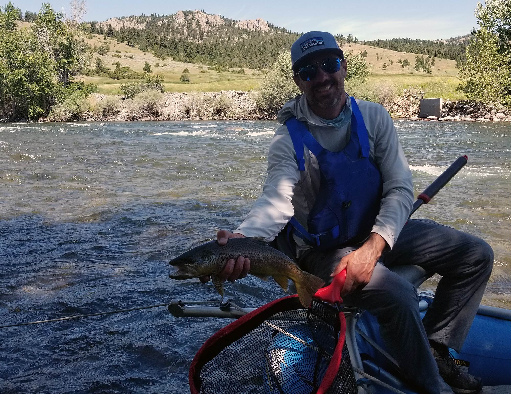 angler with boulder river brown trout