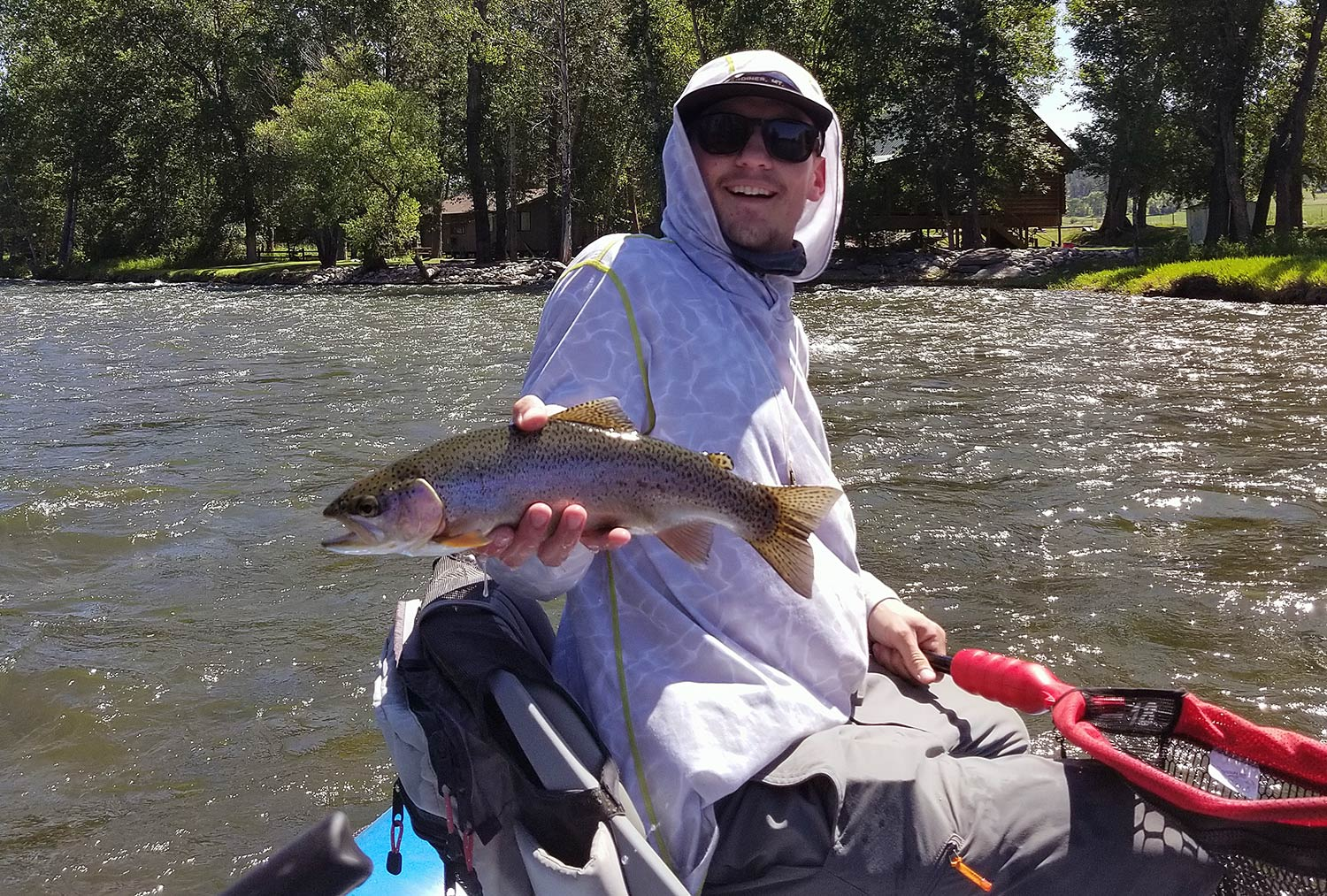 Angler with Stillwater River rainbow trout